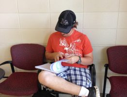 Jones County Junior College student Abel Hall studying in the lobby of the Bush Fine Arts Building.