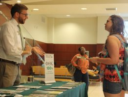 A JCJC student discussing educational options with a recruiter from Delta State University.
