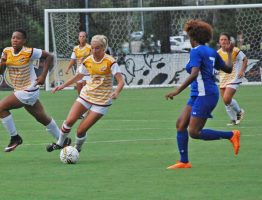 JCJC Bobcat forward Mary Kate Smith dribbling to ball downfield.