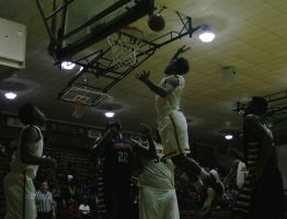 A JCJC basketball player going up for the ball during a game last season.
