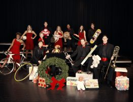 Students from JC Voices and the JCJC Jazz Band holding toys to be given to charity.